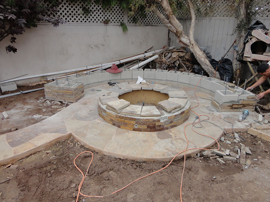 Stone fire pit and bench gemini 2 landscape construction for Outdoor fire pit construction