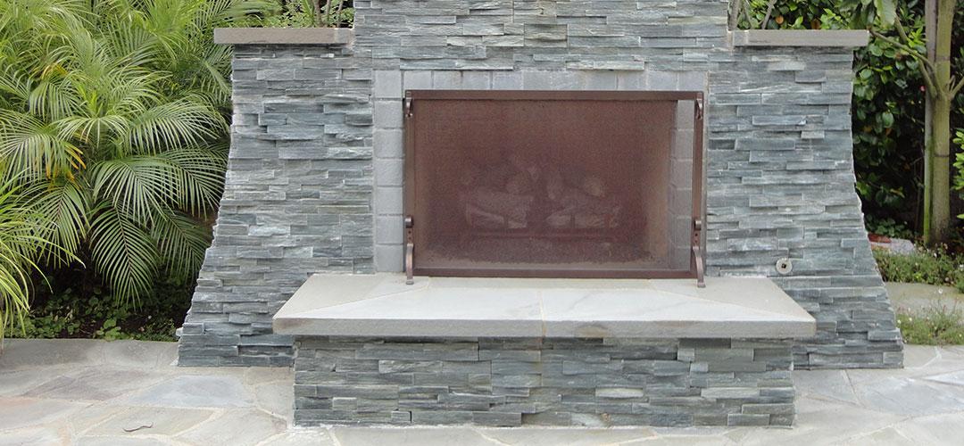 Stone Fireplace and Sport Court - Gemini 2 Landscape Construction